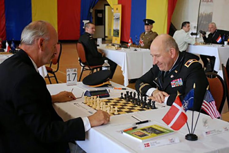 Driver David Hater provides package delivery services and plays chess